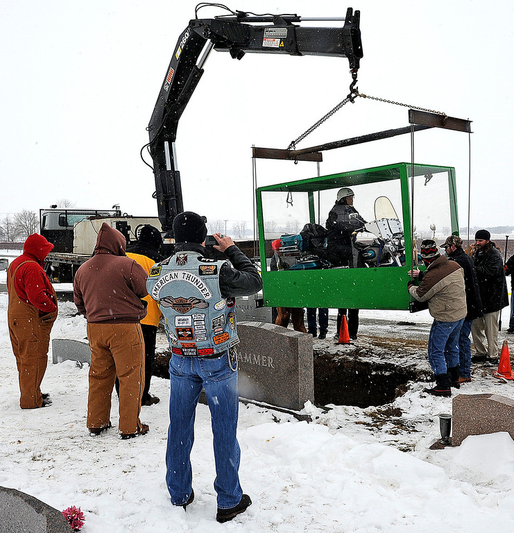 . The family of Billy Standley, of Mechanicsburg, Ohio, carried out his wish to be buried on his 1967 Harley Davidson motorcycle Friday, Jan. 31, 2014, burying him in a large Plexiglas casket at Fairview Cemetery in Crawford County, Ohio. (AP Photo/The News-Sun, Marshall Gorby)