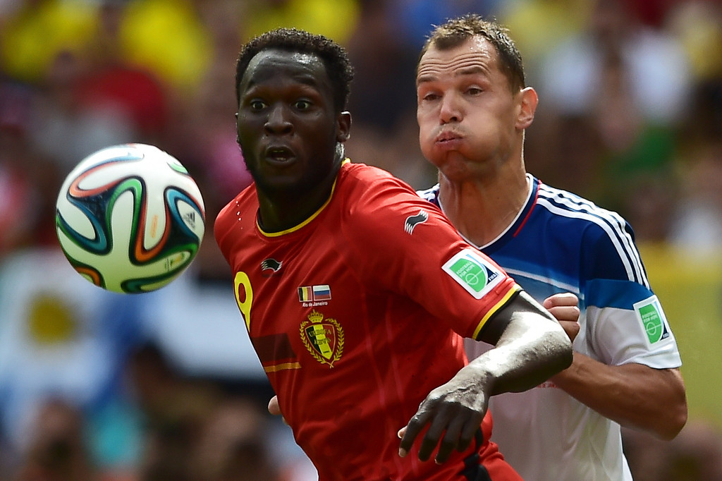 . Russia\'s defender and captain Sergey Ignashevich (R) watches Belgium\'s forward Romelu Lukaku control the ball during the Group H football match between Belgium and Russia at The Maracana Stadium in Rio de Janeiro on June 22, 2014, during the 2014 FIFA World Cup.   GABRIEL BOUYS/AFP/Getty Images