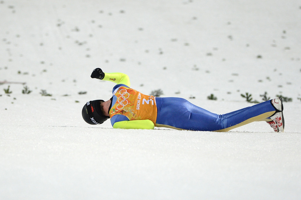 . Canada\'s Matthew Rowley falls in the Men\'s Ski Jumping Team 1st Round at the RusSki Gorki Jumping Center during the Sochi Winter Olympics on February 17, 2014, in Rosa Khutor, near Sochi.  AFP PHOTO / PETER PARKS/AFP/Getty Images