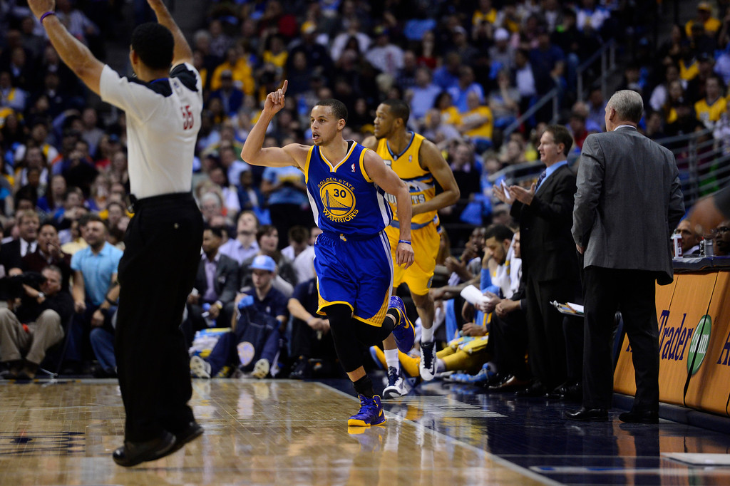 . DENVER, CO. - APRIL 23: Golden State Warriors point guard Stephen Curry (30) celebrates a three-pointer in the third quarter. The Denver Nuggets took on the Golden State Warriors in Game 2 of the Western Conference First Round Series at the Pepsi Center in Denver, Colo. on April 23, 2013. (Photo by AAron Ontiveroz/The Denver Post)
