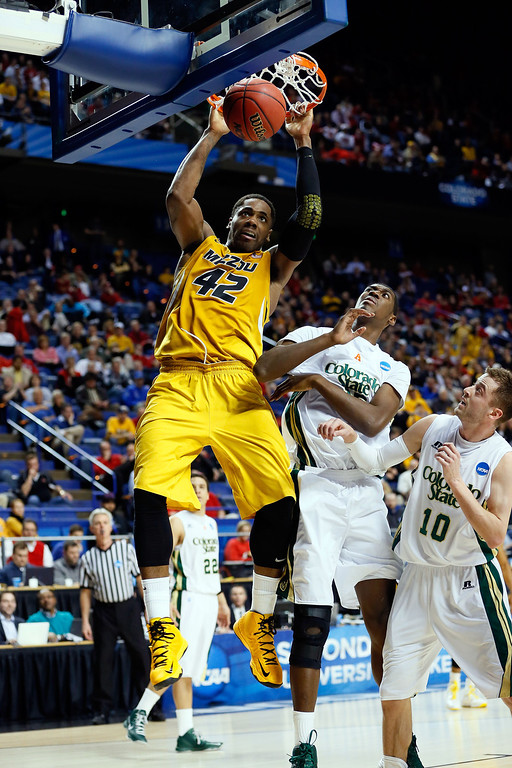 . LEXINGTON, KY - MARCH 21:  Alex Oriakhi #42 of the Missouri Tigers dunks the ball against Wes Eikmeier #10 and Gerson Santo #15 of the Colorado State Rams during the second round of the 2013 NCAA Men\'s Basketball Tournament at the Rupp Arena on March 21, 2013 in Lexington, Kentucky.  (Photo by Kevin C. Cox/Getty Images)