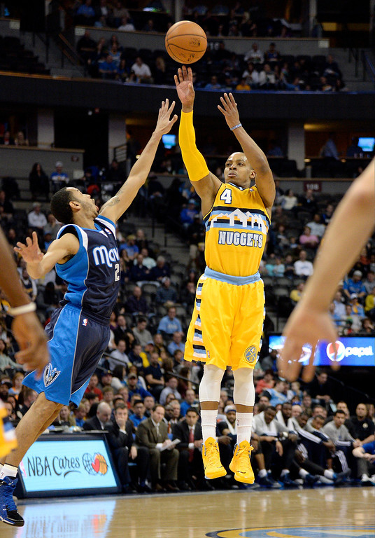 . Denver Nuggets shooting guard Randy Foye (4) takes a shot over Dallas Mavericks point guard Devin Harris (20) during the first quarter March 5, 2014 at Pepsi Center. (Photo by John Leyba/The Denver Post)