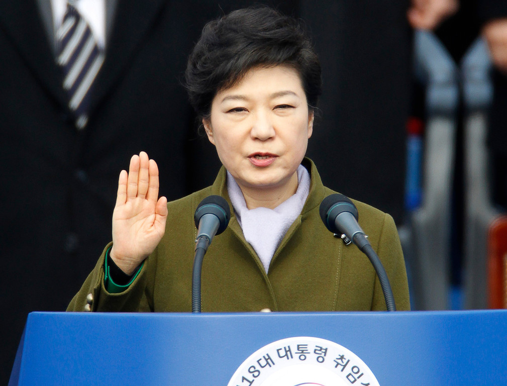 . South Korea\'s new President Park Geun-hye takes the oath of office during her inauguration at the parliament in Seoul February 25, 2013. Park became the first female president of South Korea on Monday, the daughter of former military dictator Park Chung-hee who took power in a military coup in 1961 and ruled the country for 18 years.  REUTERS/Lee Jae-Won