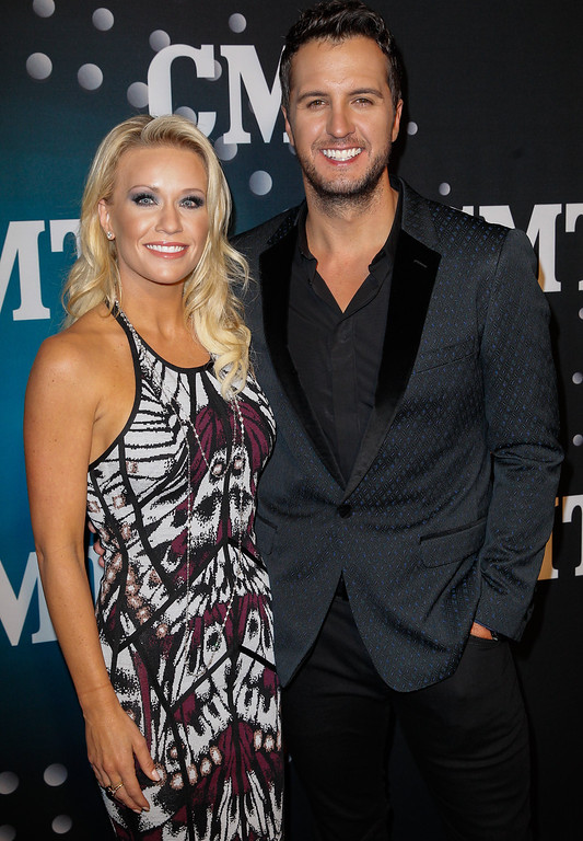 . Luke Bryan and wife Caroline attend CMT Artists Of The Year 2013 on December 3, 2013 in Nashville, Tennessee.  (Photo by Terry Wyatt/Getty Images)
