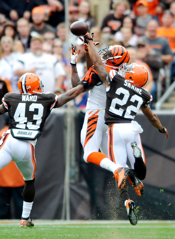 . Cleveland Browns cornerback Buster Skrine (22) knocks away a pass against Cincinnati Bengals wide receiver Mohamed Sanu as strong safety T.J. Ward (43) assists in the second quarter of an NFL football game Sunday, Sept. 29, 2013, in Cleveland. Skrine was called for pass interference on the play. (AP Photo/David Richard)