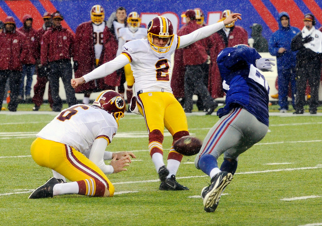 . Washington Redskins\' Kai Forbath (2) kicks a field goal during the first half of an NFL football game against the New York Giants, Sunday, Dec. 29, 2013, in East Rutherford, N.J.  (AP Photo/Bill Kostroun)