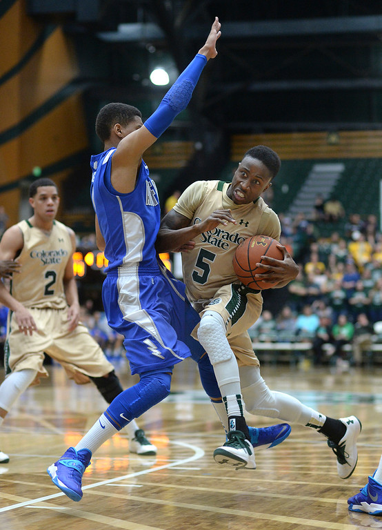 . FORT COLLINS, CO. - JANUARY 18:  Colorado State guard Jon Octeus (5) tried to penetrate past Air Force defender Tre Coggins (1) in the second half. The Colorado State men\'s basketball team defeated Air Force 74-68 at Moby Arena in Fort Collins Saturday night, January 18, 2014. Photo By Karl Gehring/The Denver Post