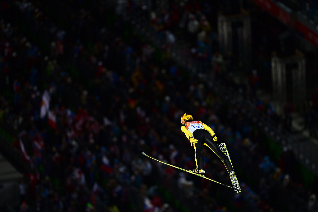 . Japan\'s Noriaki Kasai competes in the Men\'s Ski Jumping Normal Hill Individual Final Round trial at the RusSki Gorki Jumping Center during the Sochi Winter Olympics on February 9, 2014 in Rosa Khutor. JOHN MACDOUGALL/AFP/Getty Images