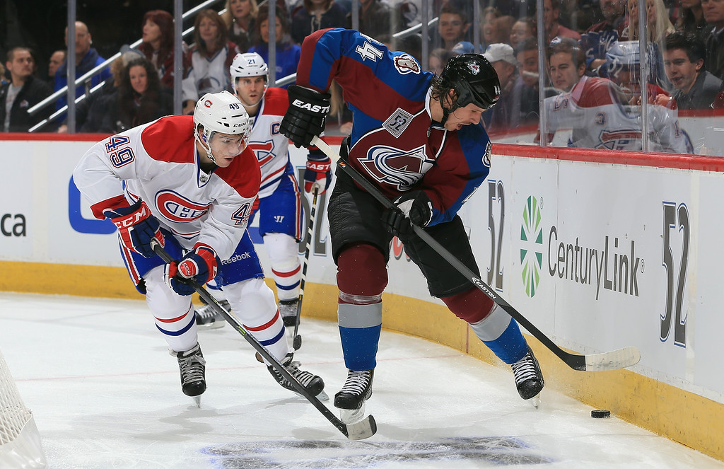 . DENVER, CO - NOVEMBER 02:  Ryan Wilson #44 of the Colorado Avalanche controls the puck against Michael Bournival #49 of the Montreal Canadiens at Pepsi Center on November 2, 2013 in Denver, Colorado.  (Photo by Doug Pensinger/Getty Images)