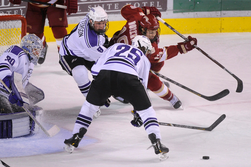 . DENVER, CO. - OCTOBER 25: Denver center Daniel Doremus (19) tried to wrap around the net late in the third period. The University of Denver hockey team defeated Niagara 5-1 at Magness Arena Friday night, October 25, 2013. Photo By Karl Gehring/The Denver Post
