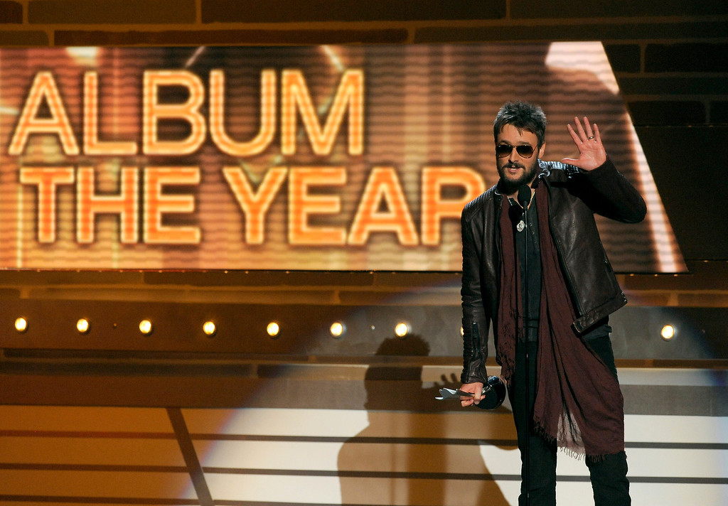 """. Eric Church accepts the award for album of the year for \""""Chief\"""" at the 48th Annual Academy of Country Music Awards at the MGM Grand Garden Arena in Las Vegas on Sunday, April 7, 2013. (Photo by Chris Pizzello/Invision/AP)"""
