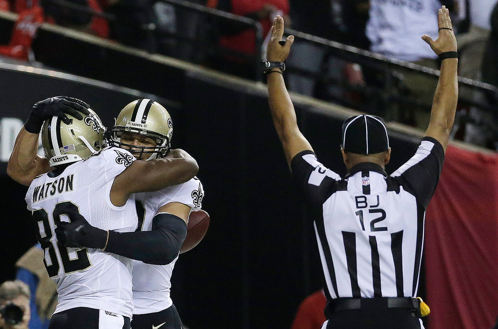 . New Orleans Saints tight end Jimmy Graham, right, embraces New Orleans Saints tight end Benjamin Watson (82) after Graham scored a touchdown against the Atlanta Falcons during the first half of an NFL football game, Thursday, Nov. 21, 2013, in Atlanta. (AP Photo/John Bazemore)