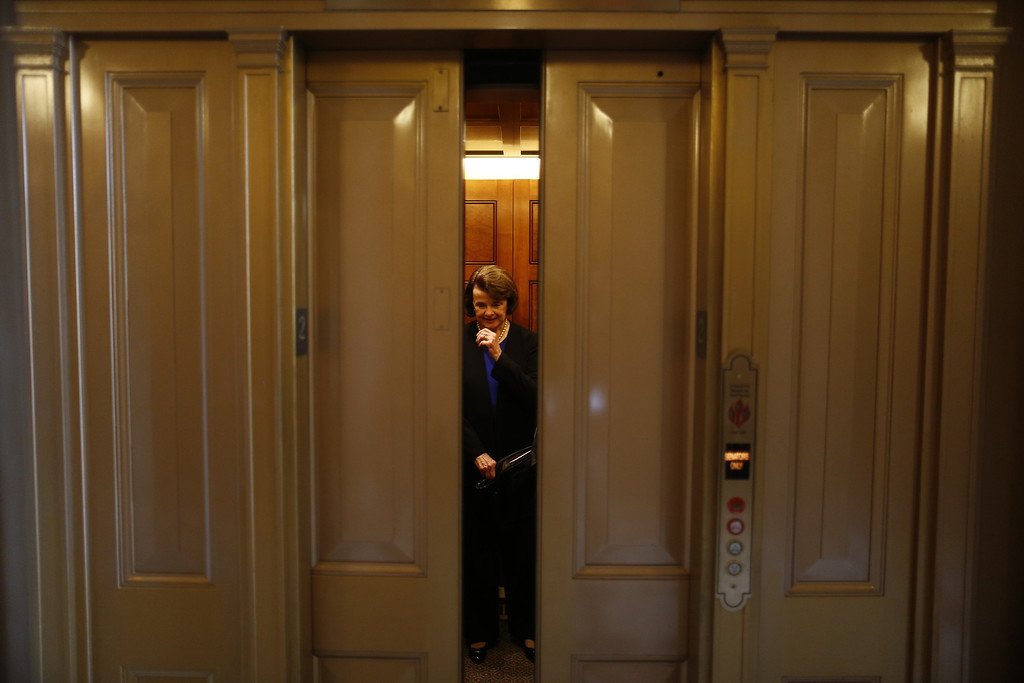 . Sen. Dianne Feinstein, D-Calif. is seen in an elevator on Capitol Hill in Washington, Wednesday, April 17, 2013, after speaking on the Senate floor about gun legislation. A bipartisan effort to expand background checks was in deep trouble Wednesday as the Senate approached a long-awaited vote on the linchpin of the drive to curb gun violence.  (AP Photo/Charles Dharapak)