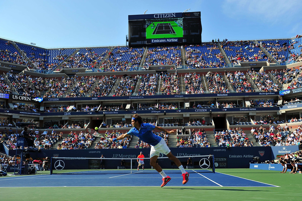 . Roger Federer of Switzerland returns a shot to Grega Zemlja of Slovenia during their 2013 US Open men\'s singles match at the USTA Billie Jean King National Tennis Center August 27, 2013 in New York. STAN HONDA/AFP/Getty Images