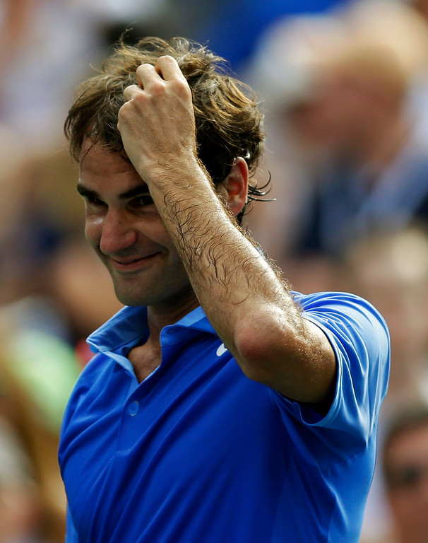 . Roger Federer, of Switzerland, reacts after beating Carlos Berlocq, of Argentina, during the second round of the 2013 U.S. Open tennis tournament, Thursday, Aug. 29, 2013, in New York. (AP Photo/Kathy Willens)
