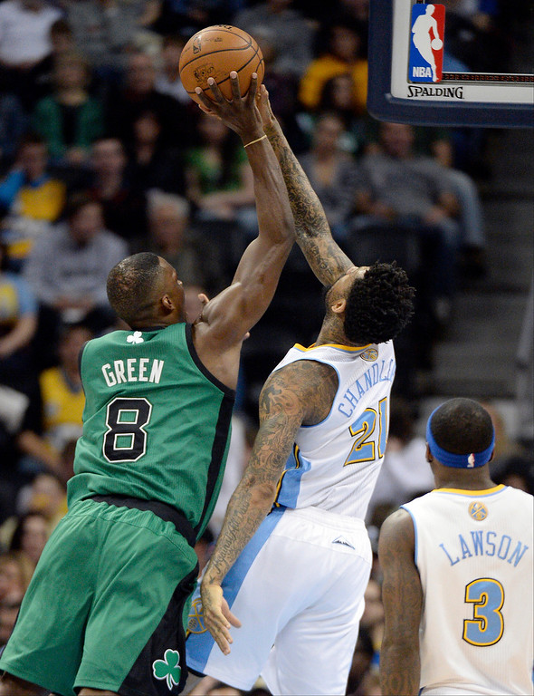. Denver Nuggets small forward Wilson Chandler (21) blocks a shot by Boston Celtics small forward Jeff Green (8) during the first quarter January 7, 2014 at Pepsi Center. (Photo by John Leyba/The Denver Post)