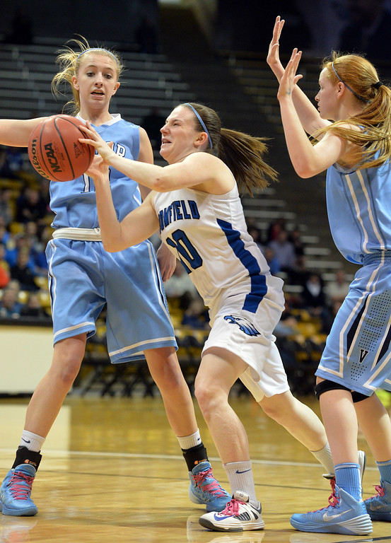 . Broomfield\'s Bri Wilbur passes the ball between Valor Christian\'s Heidi Hammond and Meaghan Foley during the final four 4A state game at Coors Event Center. (David R. Jennings/Broomfield Enterprise)