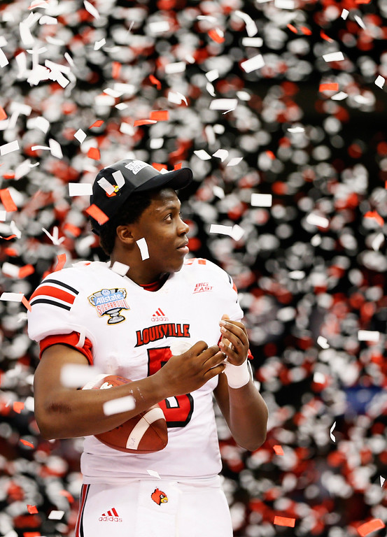 . Teddy Bridgewater #5 of the Louisville Cardinals celebrates after their 33 to 23 win over the Florida Gators in the Allstate Sugar Bowl at Mercedes-Benz Superdome on January 2, 2013 in New Orleans, Louisiana.  (Photo by Kevin C. Cox/Getty Images)