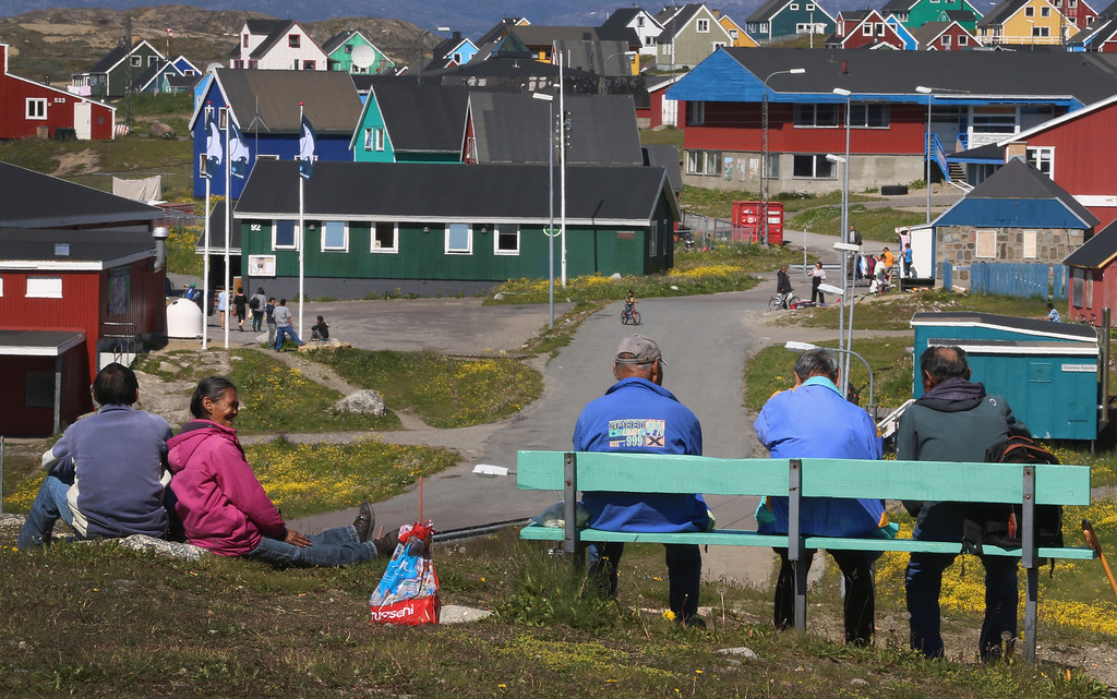 . People relax and enjoy the warm weather on July 30, 2013 in Narsaq, Greenland.  (Photo by Joe Raedle/Getty Images)