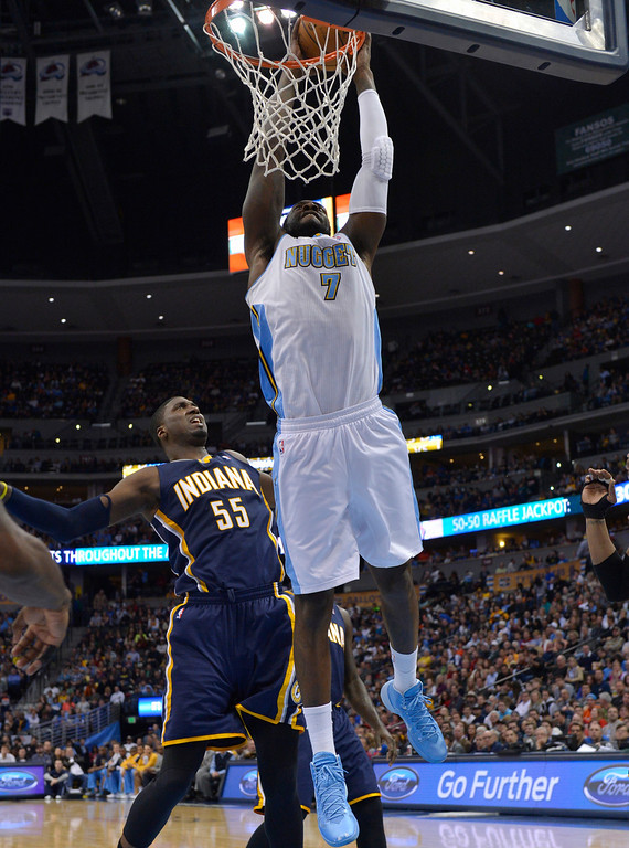 . Denver Nuggets center J.J. Hickson (7) dunks over Indiana Pacers center Roy Hibbert (55) during the second quarter of an NBA basketball game Saturday, Jan. 25, 2014, in Denver. (AP Photo/Jack Dempsey)