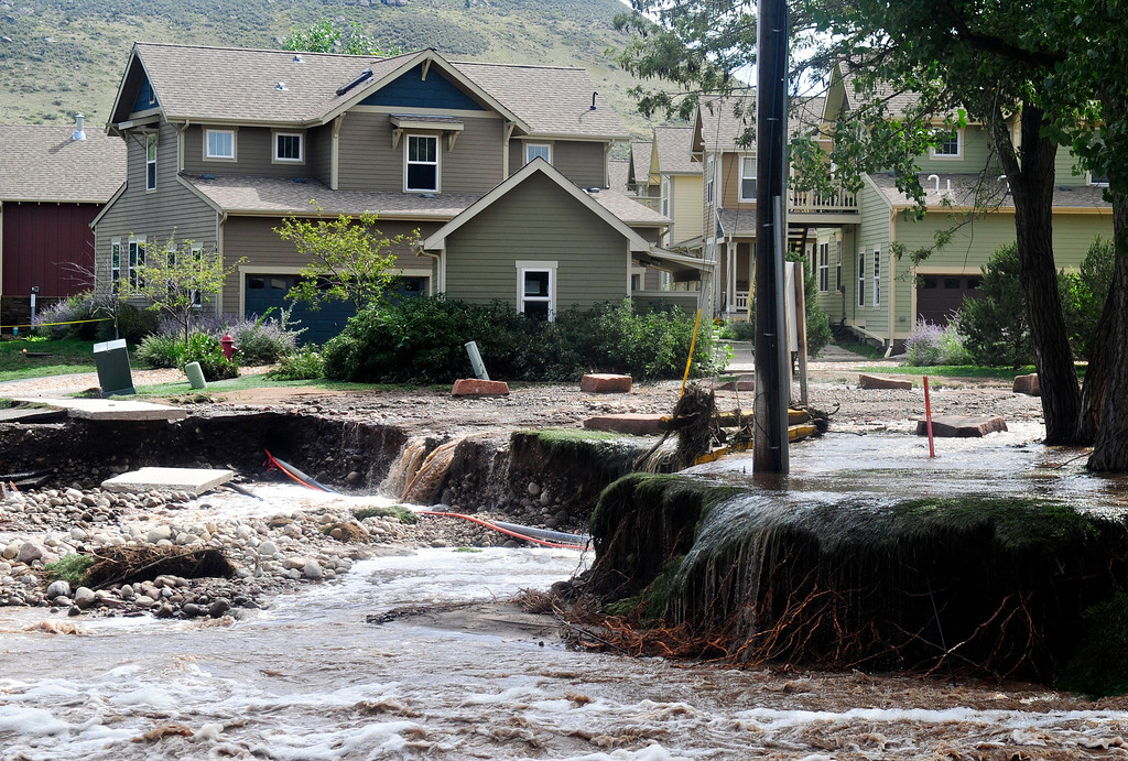 . Flood water broke through the underpass along Second Avenue near Bohn Park in Lyons Friday, Sept. 13, 2013.  (Greg Lindstrom/Times-Call)