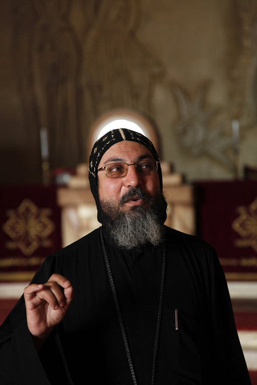 . Father Yacoub, deputy head of the St. Anthony monastery, speaks to the Associated Press inside the monastery, southeast of Cairo, Egypt on Tuesday, April 16, 2013. In a cave high in the desert mountains of eastern Egypt, the man said to be the father of monasticism took refuge from the temptations of the world some 17 centuries ago. The monks at the St. Anthony\'s Monastery bearing his name continue the ascetic tradition. But even they are not untouched by the turbulent times facing Egypt\'s Christians, defiantly vowing their community\'s voice won\'t be silenced amid Islamists\' rising power.   (AP Photo/Manoocher Deghati)