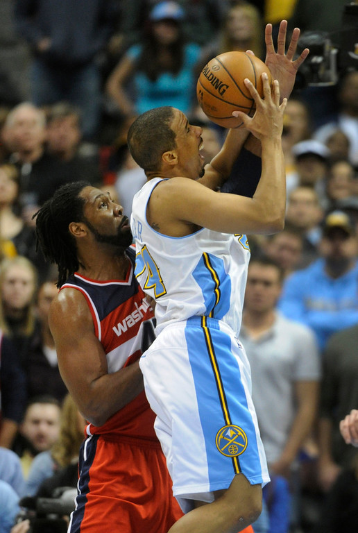 . DENVER, CO - JANUARY 18: Washington forward Nene was whistled for a foul on Denver guard Andre Miller in the second half. The Washington Wizards defeated the Denver Nuggets 112-108 at the Pepsi Center Friday night, January 18, 2013. Karl Gehring/The Denver Post