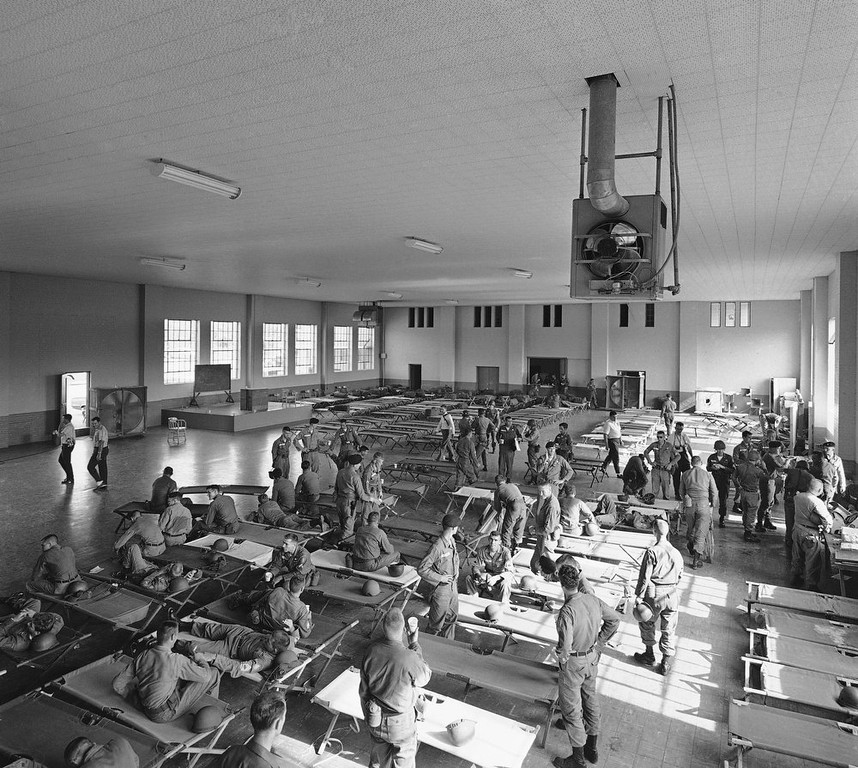 . Alabama National Guardsmen set up cots in an armory after arrival in Tuscaloosa, Ala., June 10, 1963. They were sent in by Gov. George Wallace to prevent violence when Wallace attempts to bar the entrance of two black students on the University of Alabama campus tomorrow. (AP Photo)