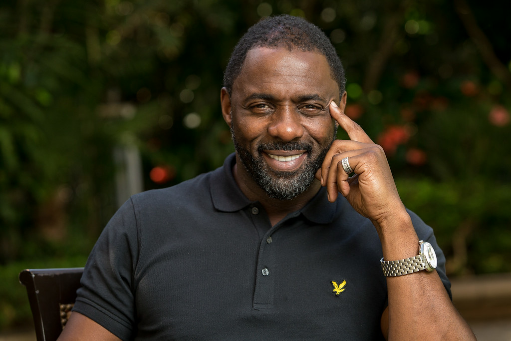 ". In this Sunday, Nov. 10, 2013 photo, actor Idris Elba poses for a portrait at the Four Seasons in Beverly Hills, Calif.  Elba was nominated for an Emmy Award for best actor in a miniseries or movie for his role in ""Luther,\"" on Thursday, July 10, 2014. The 66th Primetime Emmy Awards will be presented Aug. 25 at the Nokia Theatre in Los Angeles.. (Photo by Paul A. Hebert/Invision/AP)"