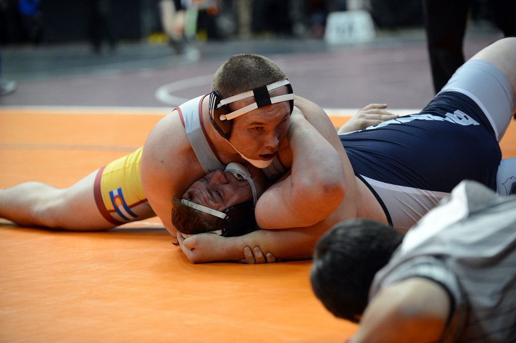 . DENVER, CO. - FEBRUARY 22: Robert Beshop-Cotner of Windsor High School, top, pins Justin Petrash of Air Academy High School during 4A 285 pound class semifinal of State Championship at Pepsi Center February 22, 2013. Denver, Colorado. (Photo By Hyoung Chang/The Denver Post)