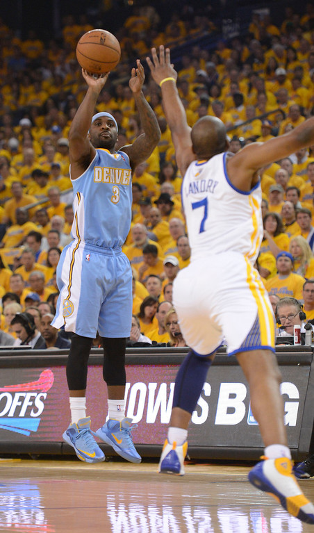 . Ty Lawson (3) of the Denver Nuggets takes a shot over Carl Landry (7) of the Golden State Warriors during the first quarter  in Game 6 of the first round NBA Playoffs May 2, 2013 at Oracle Arena. (Photo By John Leyba/The Denver Post)