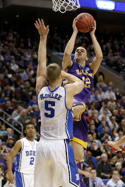. Peter Hooley #12 of the Albany Great Dane shoots over Mason Plumlee #5 of the Duke Blue Devils in the second half during the second round of the 2013 NCAA Men\'s Basketball Tournament on March 22, 2013 at Wells Fargo Center in Philadelphia, Pennsylvania.  (Photo by Rob Carr/Getty Images)