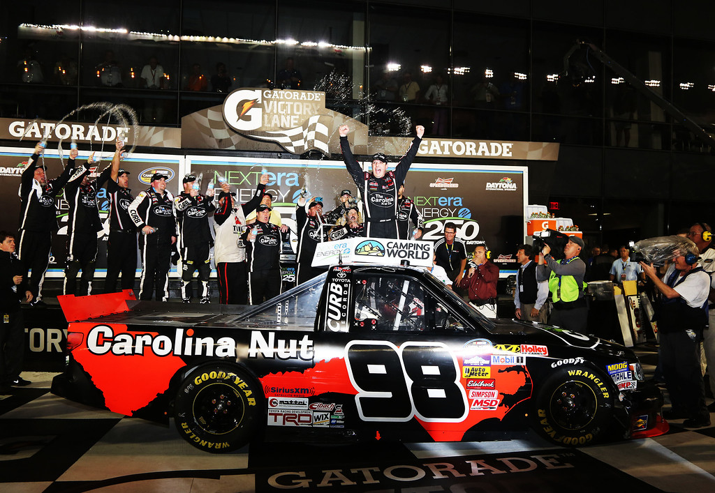 . DAYTONA BEACH, FL - FEBRUARY 22:  Johnny Sauter, driver of the #98 Carolina Nut Co./Curb Records Toyota, celebrates in victory lane after winning the NASCAR Camping World Truck Series NextEra Energy Resources 250 at Daytona International Speedway on February 22, 2013 in Daytona Beach, Florida.  (Photo by Jerry Markland/Getty Images)