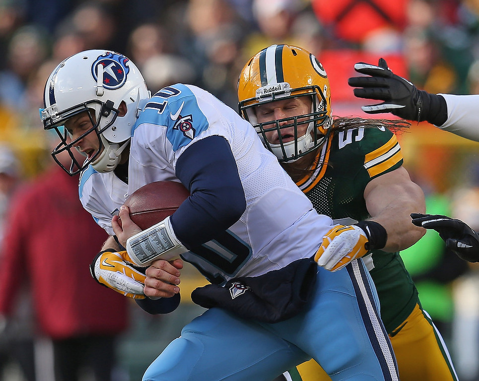 . Clay Matthews #52 of the Green Bay Packers sacks Jake Locker #10 of the Tennessee Titans at Lambeau Field on December 23, 2012 in Green Bay, Wisconsin.  (Photo by Jonathan Daniel/Getty Images)