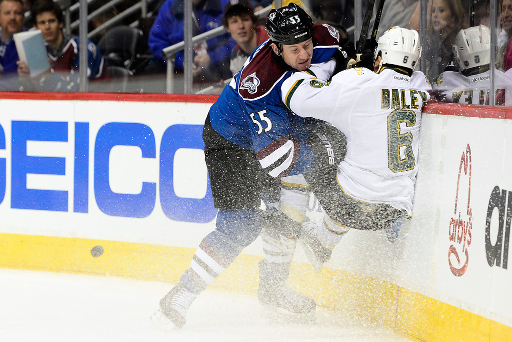 . DENVER, CO. - FEBRUARY 4: Cody McLeod (55) of the Colorado Avalanche checks Trevor Daley (6) of the Dallas Stars during the first period of action. Colorado Avalanche versus the Dallas Stars at the Pepsi Center on February 4, 2012. (Photo By AAron Ontiveroz/The Denver Post)