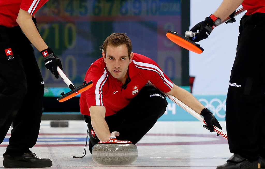. Switzerland\'s skip Michel Sven delivers the rock during the men\'s curling competition at the 2014 Winter Olympics, Thursday, Feb. 13, 2014, in Sochi, Russia. (AP Photo/Wong Maye-E)