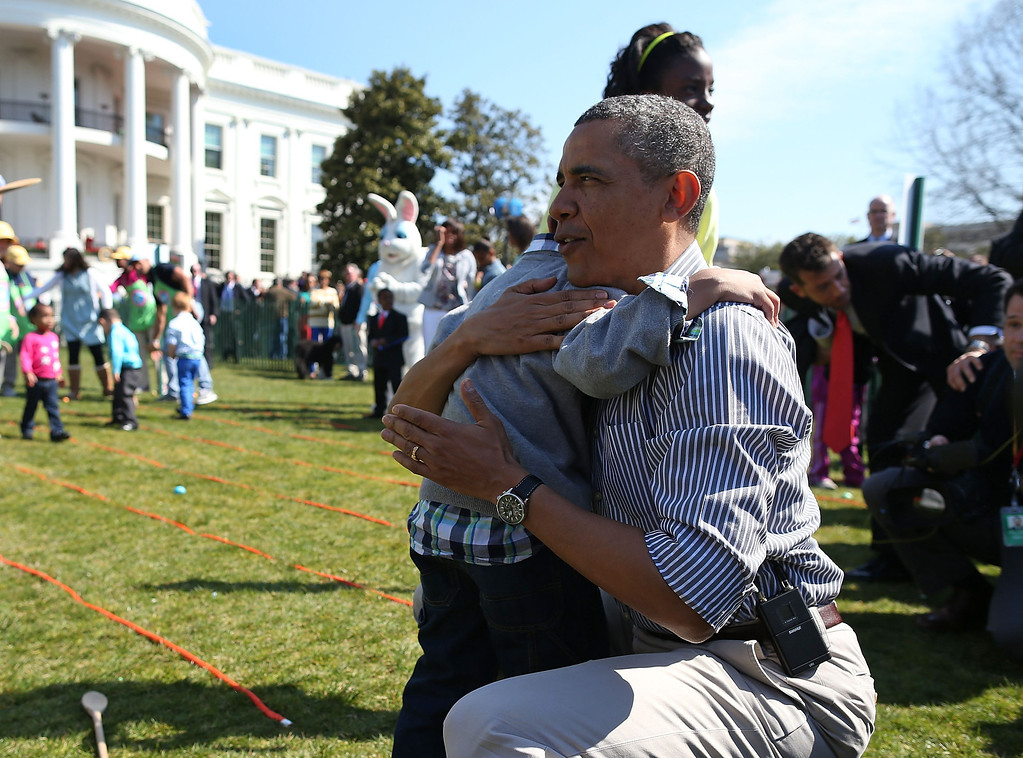 . U.S. President Barack Obama comforts crying 5 year old Donaivan Frazier during the annual Easter Egg Roll on the White House tennis court April 1, 2013 in Washington, DC. Thousands of people are expected to attend the 134-year-old tradition of rolling colored eggs down the White House lawn that was started by President Rutherford B. Hayes in 1878.  (Photo by Mark Wilson/Getty Images)