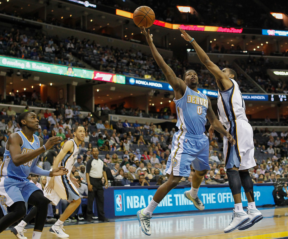 . Denver Nuggets guard Aaron Brooks (0) goes to the basket against Memphis Grizzlies guard Mike Conley (11) in the first half of an NBA basketball game Friday, April 4, 2014, in Memphis, Tenn. (AP Photo/Lance Murphey)