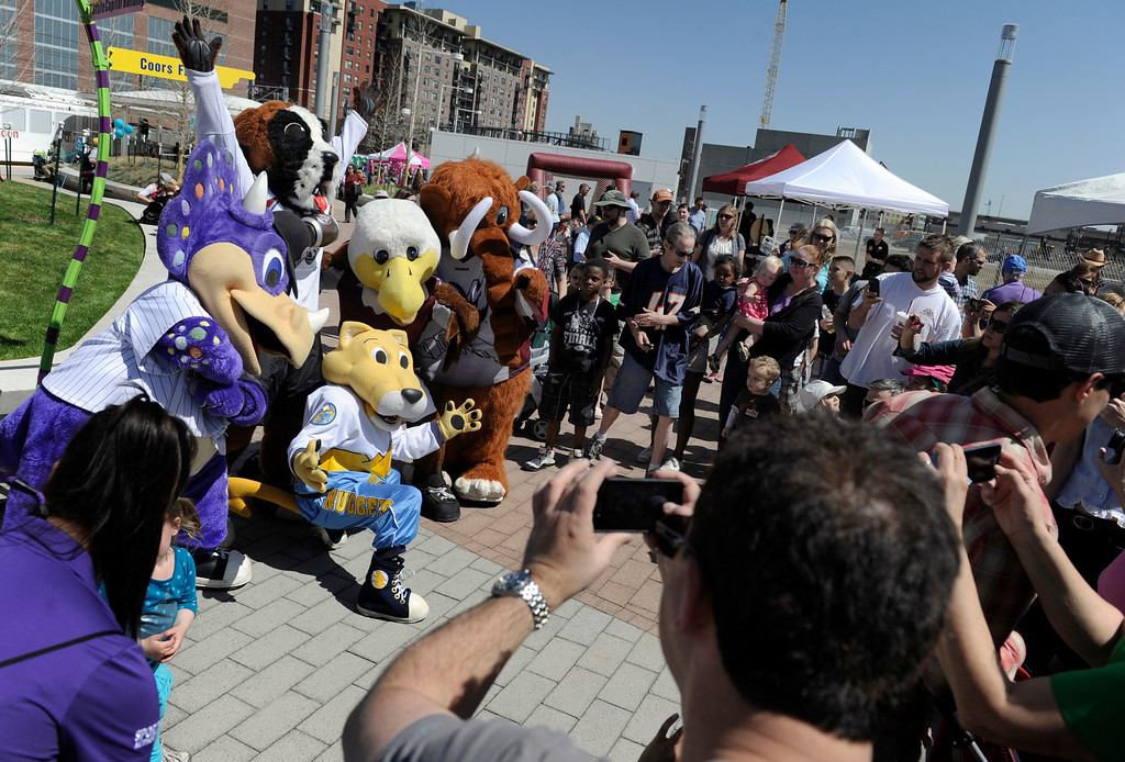 . DENVER, CO.- APRIL 27: A crowd gathers to take a photo of all the Denver sports team mascots. RTD celebrates the opening of the West line of the light rail with free rides for all and a party atmosphere at many of the stops along the route. Union station had Denver sports team mascots making the rounds as well as live music and food. (Photo By Kathryn Scott Osler/The Denver Post)