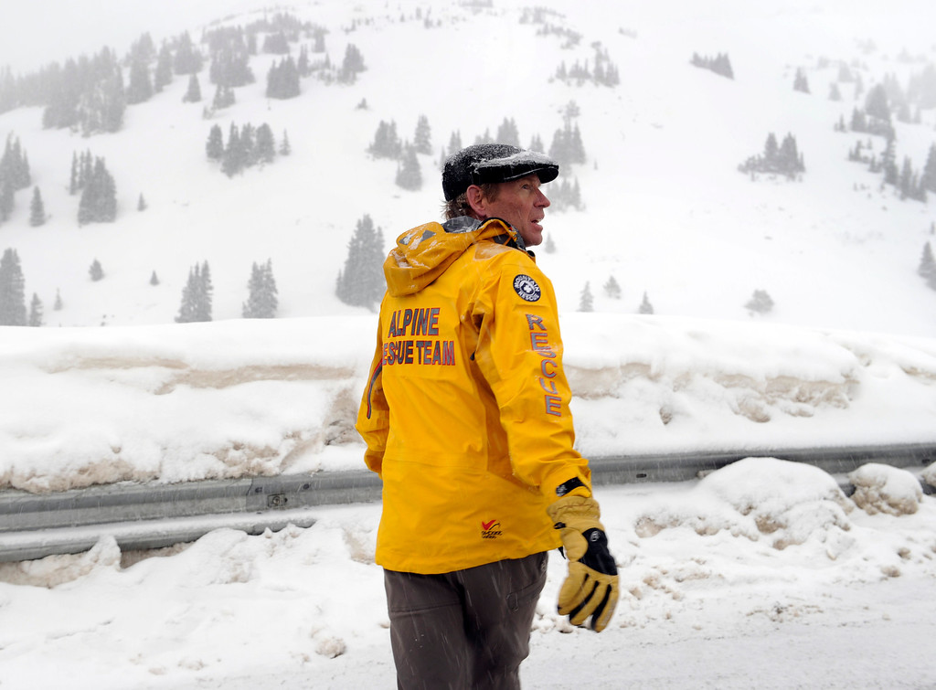 . LOVELAND PASS, CO. - APRIL 20:  Alpine Resuce Team member Dale Atkins crossed Highway 6 near the scene of the deadly avalanche Saturday night A ten-foot thick slab of snow broke free and buried six backcountry thick snowboarders in an avalanche in Sheep Creek Bowl below Loveland Pass Saturday, April 20, 2013.  One survived but the others five died at the scene. Photo By Karl Gehring/The Denver Post