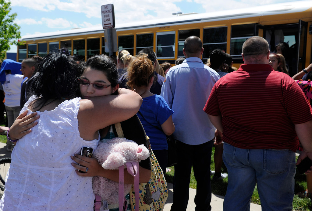. Vida Zamora, left, is very happy to see her daughter Dakota, 17, as she gets off the bus after being evacuated from Thornton High School. Parents of Thornton High School students meet their children a few blocks from the school after Thornton police evacuated the school when they received a report of two people with a gun on campus. (Photo By Kathryn Scott Osler/The Denver Post)