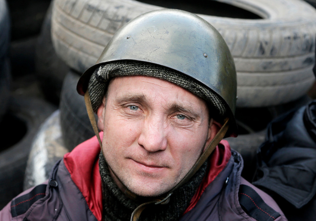. An opposition supporter stands at a barricade near the Presidential office in Kiev, Ukraine, Friday, Feb. 21, 2014. (AP Photo/Efrem Lukatsky)