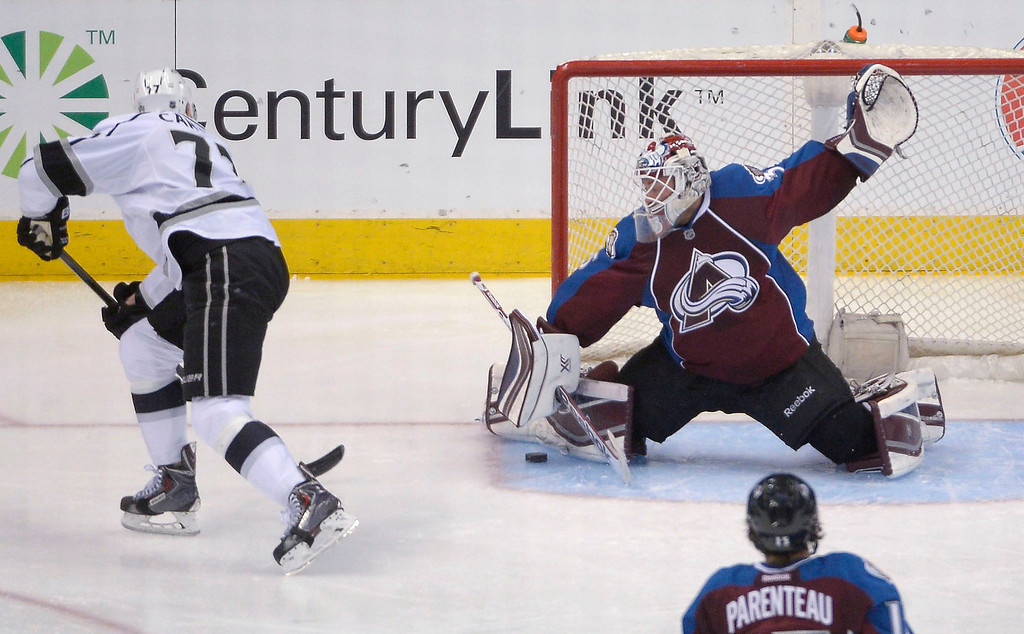 . Colorado Avalanche goalie Jean-Sebastien Giguere (35) makes a save on a break away shot by Los Angeles Kings center Jeff Carter (77) during the second period February 27, 2014 at Pepsi Center. (Photo by John Leyba/The Denver Post)