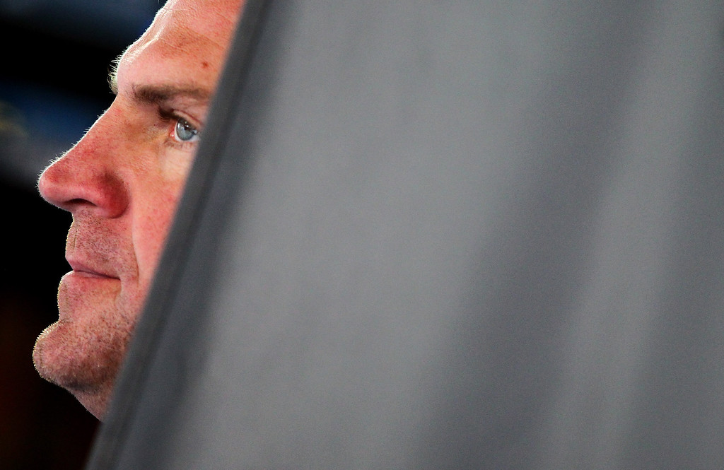 . CONCORD, NC - OCTOBER 11:  Clint Bowyer, driver of the #15 Raspberry 5-hour ENERGY benefitting Living Beyond Breast Cancer Toyota, stands in the garage area during practice for the NASCAR Sprint Cup Series Bank of America 500 at Charlotte Motor Speedway on October 11, 2013 in Concord, North Carolina.  (Photo by Jonathan Ferrey/Getty Images)