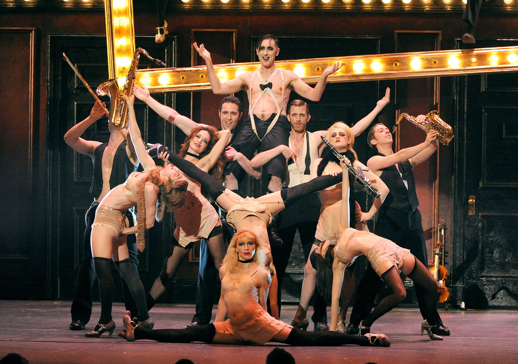 """. Alan Cumming, center top, and the cast of \""""Cabaret\"""" perform on stage at the 68th annual Tony Awards at Radio City Music Hall on Sunday, June 8, 2014, in New York. (Photo by Evan Agostini/Invision/AP)"""
