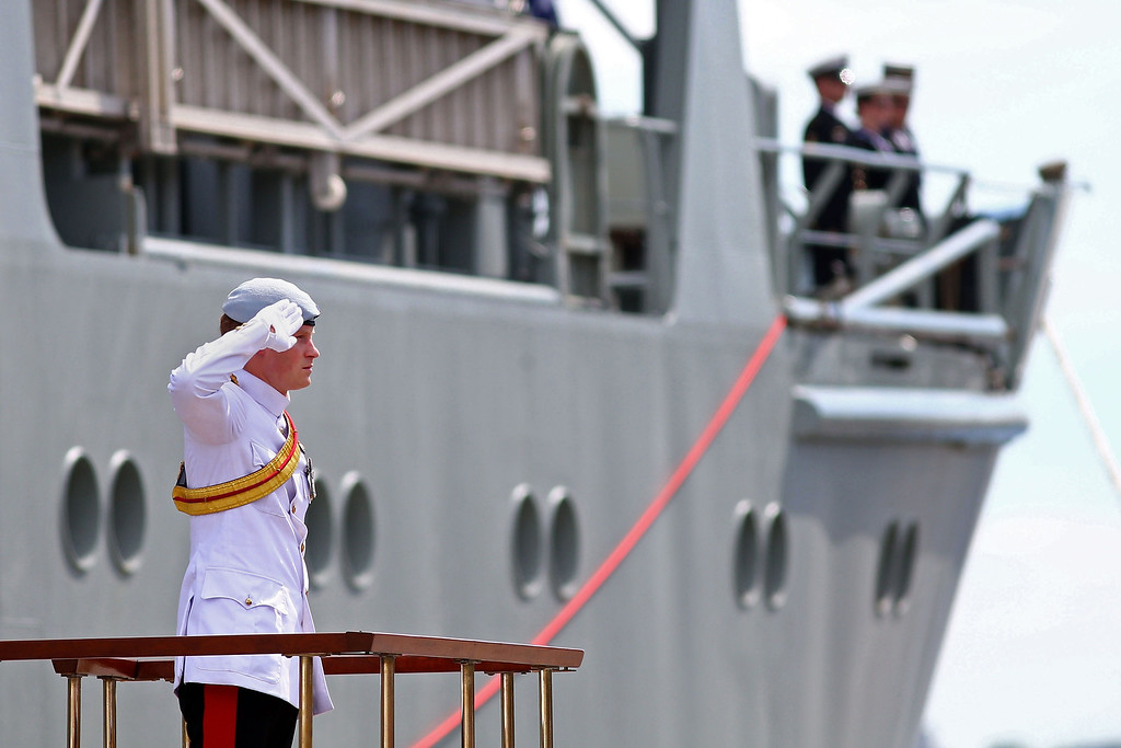 . Britain\'s Prince Harry stands and salutes as he arrives at Garden Island in Sydney to attend the 2013 International Fleet Review on October 5, 2013. The International Fleet Review commemorates the 100 year anniversary of the Royal Australian Navy\'s fleet arriving into Sydney. Prince Harry is an official guest of the Australian Government and will take part in the fleet review during his two-day visit to Australia.  RYAN PIERSE/AFP/Getty Images