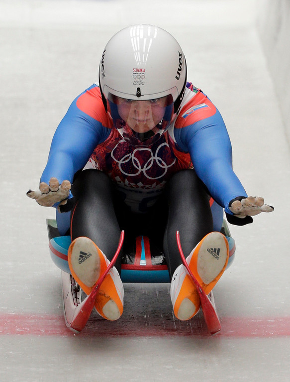 . Viera Gburova of Slovakia starts her second run during the women\'s singles luge competition at the 2014 Winter Olympics, Monday, Feb. 10, 2014, in Krasnaya Polyana, Russia. (AP Photo/Jae C. Hong)
