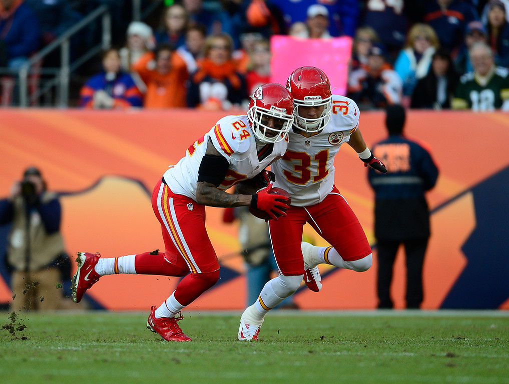 . Kansas City Chiefs cornerback Brandon Flowers (24) recovers a fumble by Denver Broncos running back Ronnie Hillman (21) in the second quarter as the Denver Broncos took on the Kansas City Chiefs at Sports Authority Field at Mile High in Denver, Colorado on December 30, 2012. AAron Ontiveroz, The Denver Post