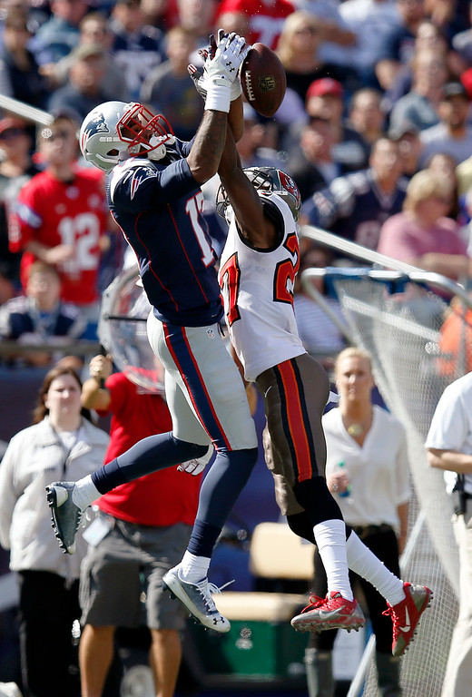 . Tampa Bay Buccaneers cornerback Johnthan Banks (27) breaks up a pass intended for New England Patriots wide receiver Aaron Dobson (17) in the first half of an NFL football game Sunday, Sept. 22, 2013, in Foxborough, Mass. (AP Photo/Elise Amendola)