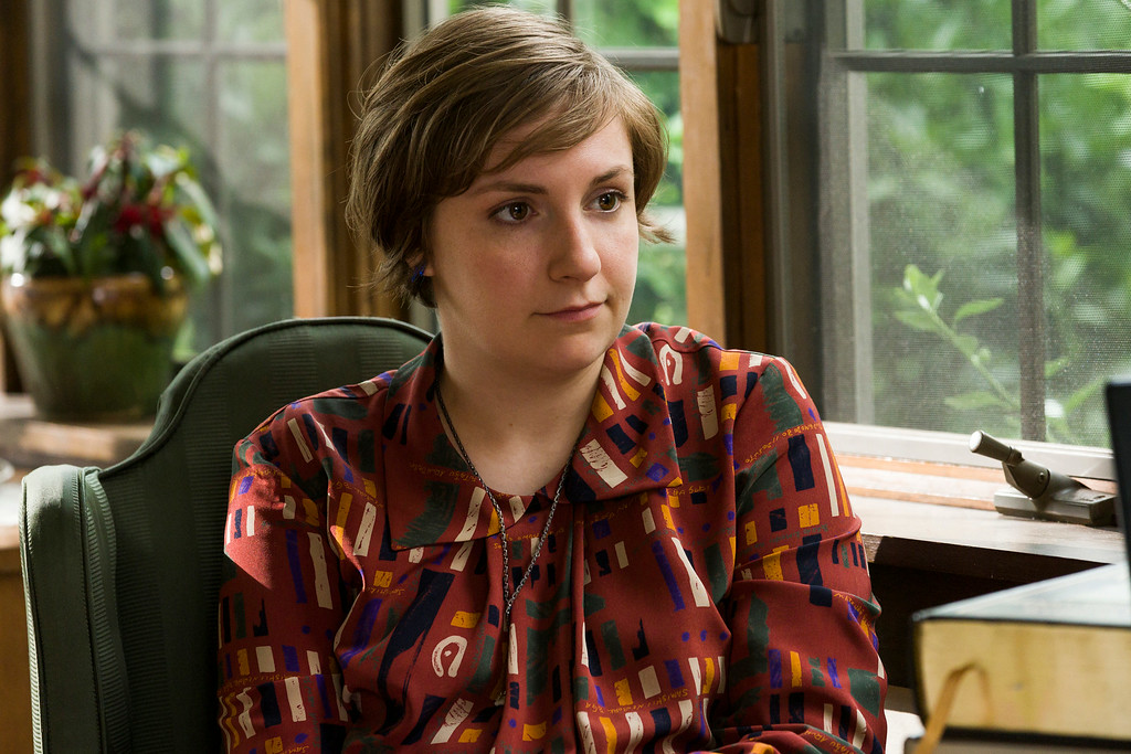 ". This image released by HBO shows Lena Dunham in a scene from ""Girls.\"" Dunham was nominated for an Emmy Award for best actress in a comedy series on Thursday, July 10, 2014. The 66th Primetime Emmy Awards will be presented Aug. 25 at the Nokia Theatre in Los Angeles. (AP Photo/HBO, Mark Schafer)"